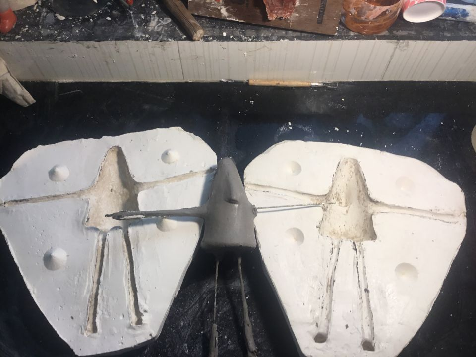 Got success for making two half mould for silicon casting puppet. Mould is made from POP.